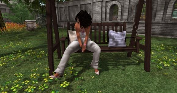 in the garden swinging